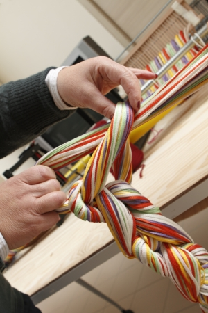 weaving: a weaver collects the skein