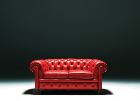 red sofa: a chestr sofa studio isolated