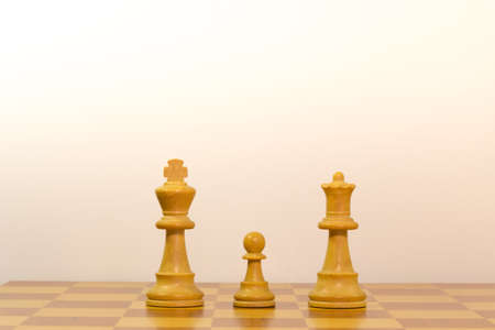 Concept of a family with pawns of chess photo