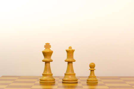 Concept of a family by pawns of chess photo