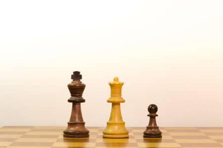Concept of a family by chess pieces photo