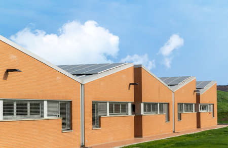 old factory: Industrial building with solar panel on the roof Stock Photo