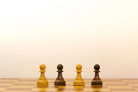 Concept of different ethnicity with pawns of chess photo