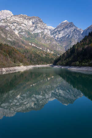 Some italian dolomites reflected in a lake photo
