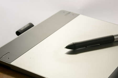 Close-up of a graphic tablet With His pen tool