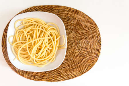 Italian spaghetti dish with tomatoes and basil photo