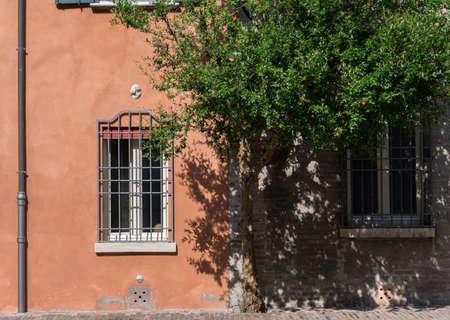 costruction: Little orange villa in a hidden garden of Ferrara Italy Stock Photo