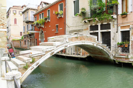 Venice, Italy, Ponte Chiodo, the only one left in Venice without a balustrade Фото со стока