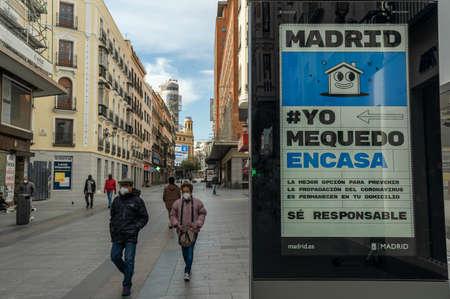 A few pedestrians walk down Preciados street, in Madrid's city center, following coronavirus lockdown Redakční