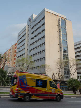 An ambulance passes by the Gran Hotel Colon in downtown Madrid. On March 19th, the Gran Hotel Colon has become the first medicalized hotel in Spain hosting patients with coronavirus mild symptoms. The hotel features 365 bedrooms to host coronavirus patien