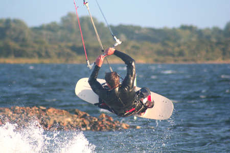 windy energy: kitesurfer in full speed