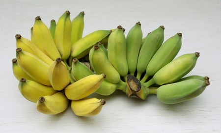 Cultivated bananas or Thai bananas on white wooden background  photo