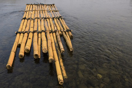bamboo raft floating in river  photo