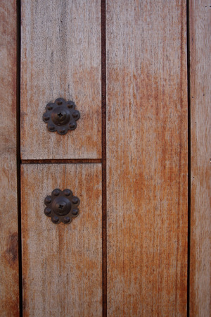 Close up of iron knot on wooden door  photo