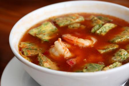 shrimp and fried egg sour soup tropical Thai style photo