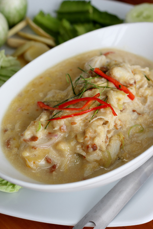 coconut crab: stew crab with coconut milk dip with fresh vegatables