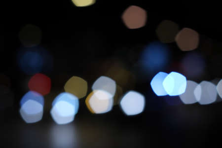 Multicolored defocused bokeh lights background photo