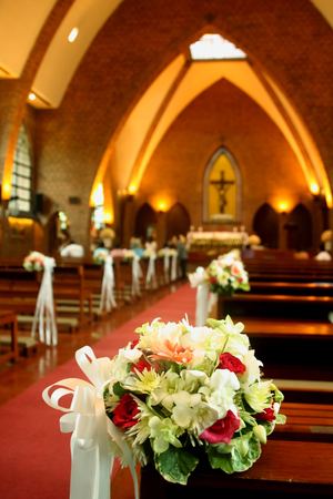 Wedding ceremony inside a church with blurry couple in background beautiful flowers wedding decoration in church photo junglespirit Image collections