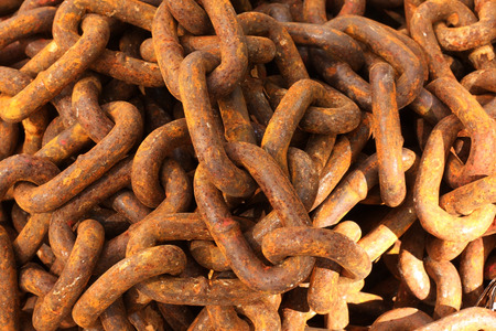 chandler: Close up of rusty chain pile.