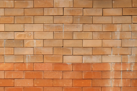 clay brick: Red clay brick wall background.