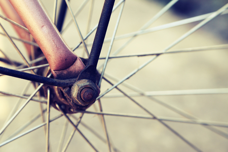close   up: Close up of bicycle wheels process in vintage retro style. Stock Photo