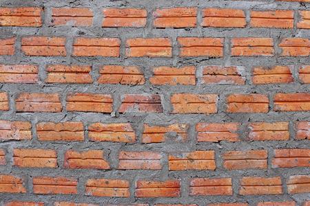 brick kiln: Wall of clay bricks texture background. Stock Photo