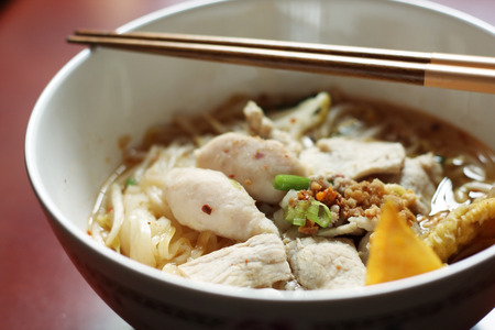 asian food: Asian rice noodle soup with pork and fish ball, selective focus.
