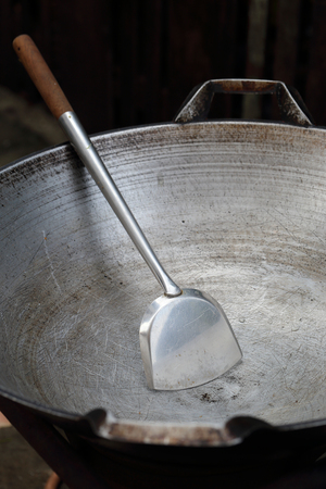 flipper: Empty big pan and scoop or flipper used in frying. Stock Photo
