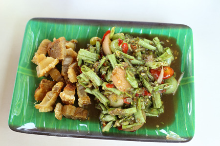 long bean: Long Bean Spicy Salad with Crispy fried streaky pork recipe. Stock Photo