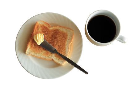 Breakfast, plate of  toast with butter and cup of black coffee, isolated on white background with clipping path.
