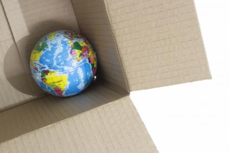 Toy earth in cardboard box