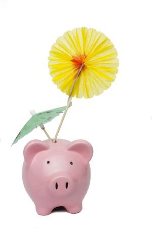 Piggy  bank with umbrella isolated on white Stock Photo