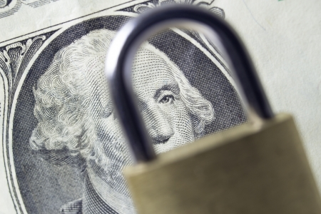 Dollar and padlock, security concept