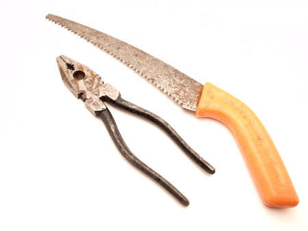flatnose: Old flat-nose pliers and saw on a white background             Stock Photo