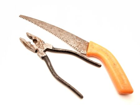 flatnose: Old flat-nose pliers and saw on a white background