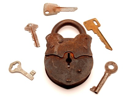 Keys and the lock on a white background