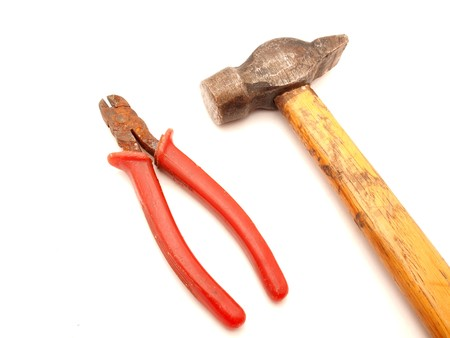 flatnose: Hammer and flat-nose pliers on a white background