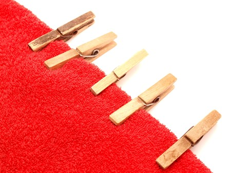 Clothespins on a towel on a white background     photo