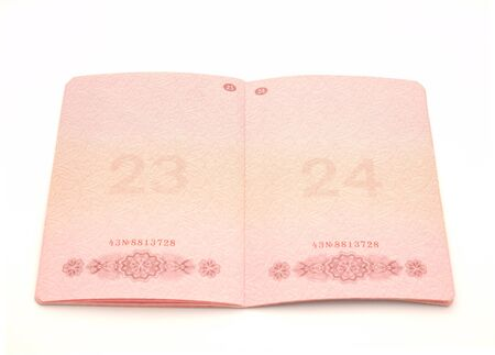 The opened passport on a white background