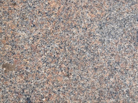 Background,highly detailed texture of granite rock surface                Stock Photo