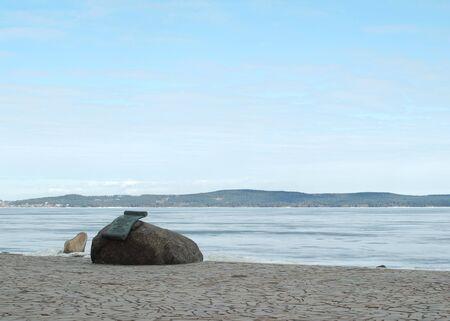 onega: Metal roll on a stone on quay of the Onega lake. Petrozavodsk, Karelia, Russia