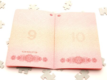 The passport and puzzle on a white background   Stock Photo