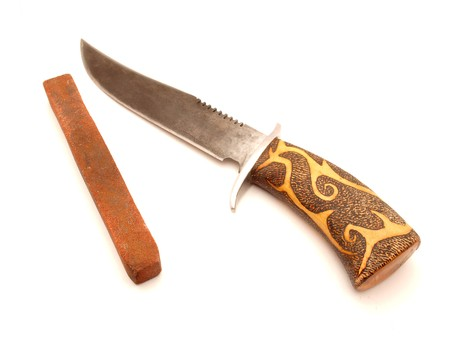 Knife and grinding stone on a white background Stock Photo - 7825996