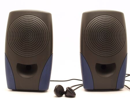 two party system: Audio dynamics and headphones on a white background     Stock Photo