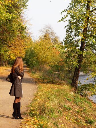 The girl in park in the autumn         Stock Photo