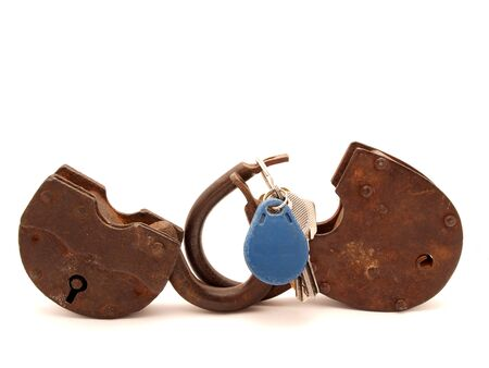 Keys and the lock on a white background Stock Photo - 7965540
