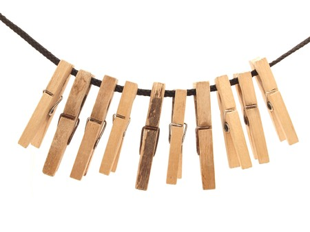 Clothespins and rope on a white background