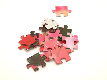 dominating: Puzzle on a white background     Stock Photo