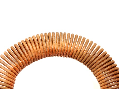 Rusty spring on a white background  photo