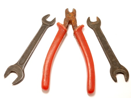 Nippers and wrenchs on a white background photo